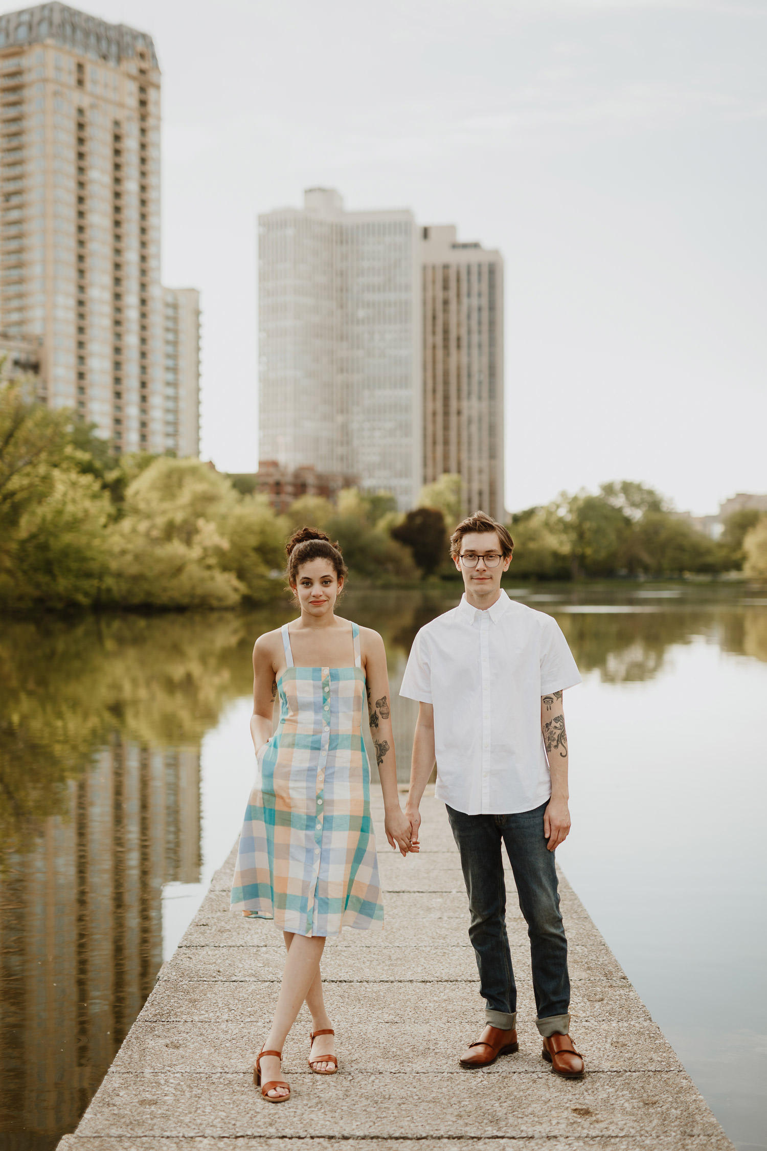 Portraits of a hipster couple photographed during the engagement shoot at North Pond in Lincoln Park