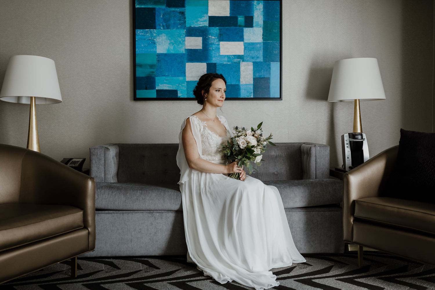 Portait of the bride sitting on the couch at the allegro hotel in Chicago