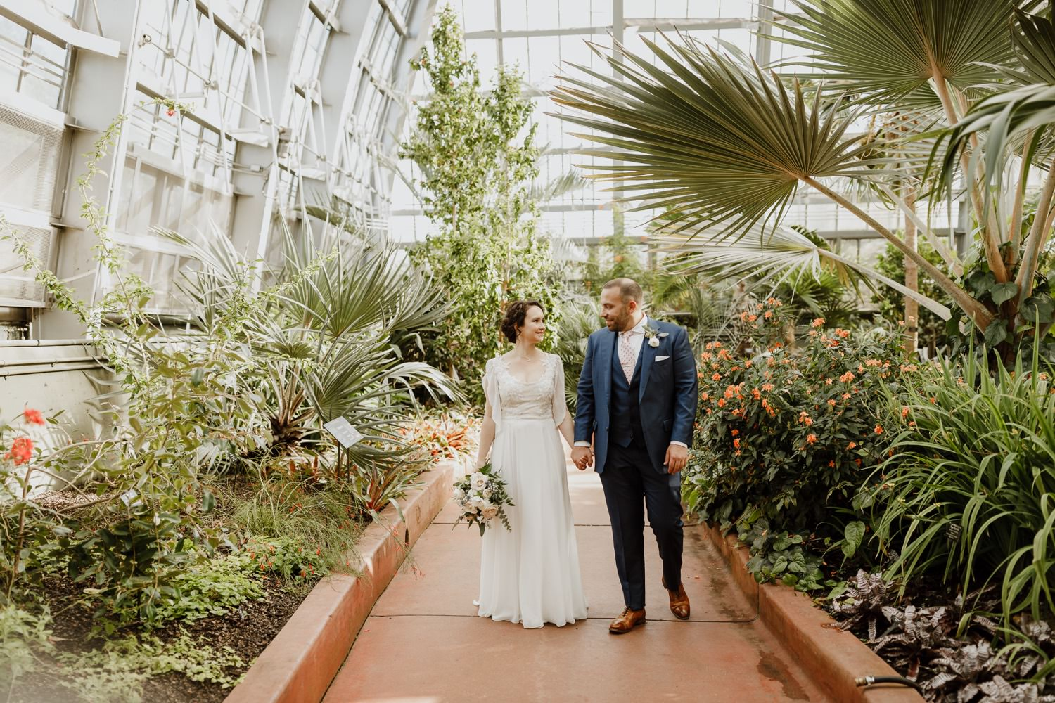 Portrait among the plants of the bride and groom at Garfield Park Conservatory. Taken on the wedding day.