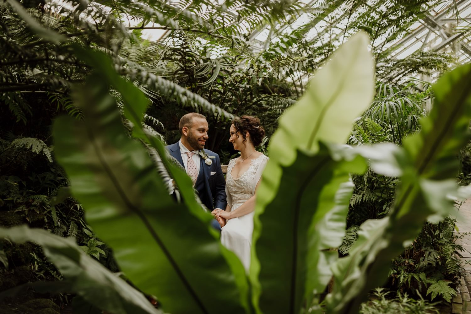 creative portrait of the bride and groom at Garfield Park Conservatory on the wedding day