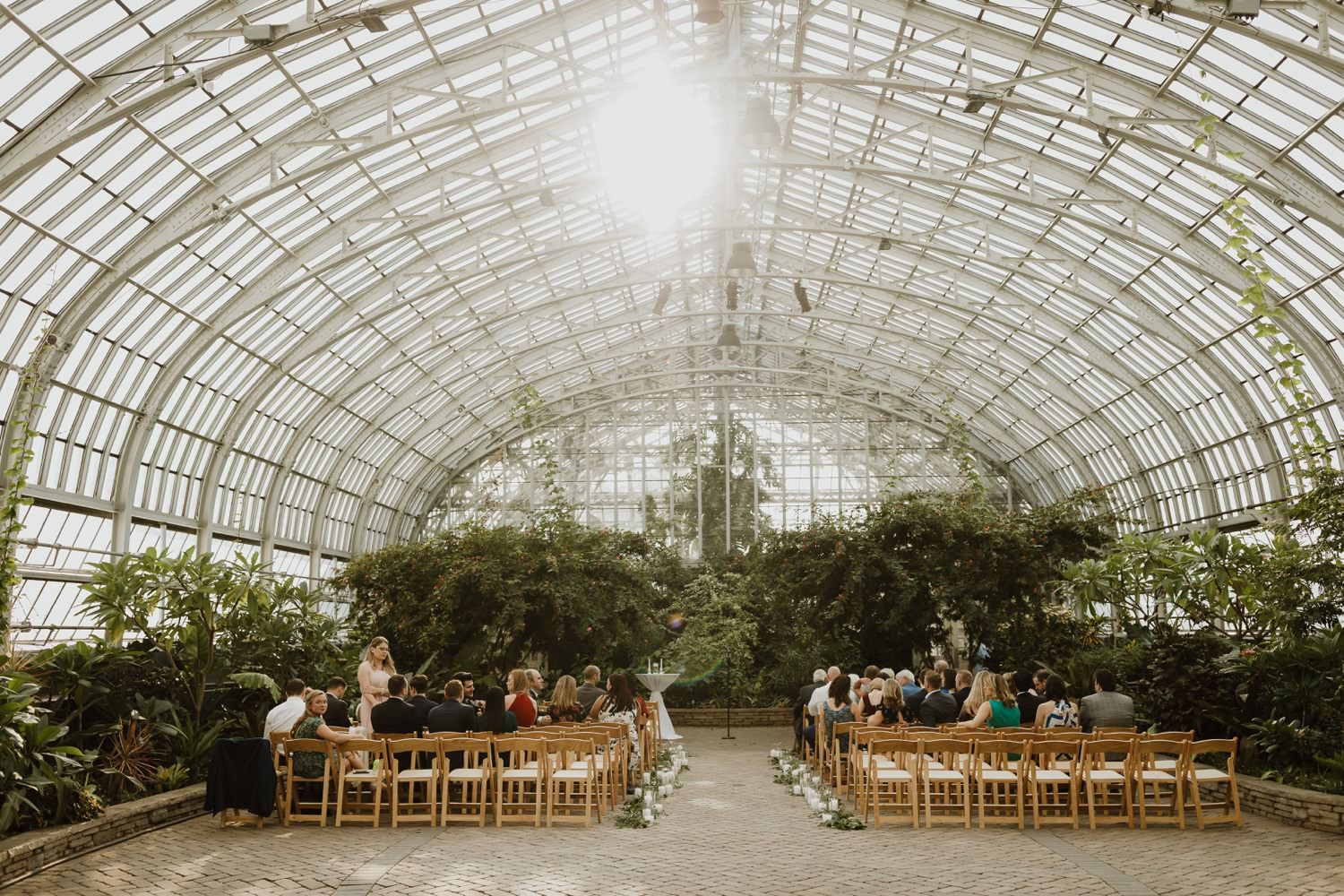 Wide angle picture of the wedding ceremony set up at Garfield Park Conservatory