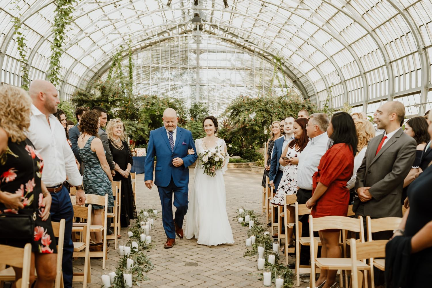 Garfield park conservatory wedding ceremony photographer. Father and the bride walking down the isle.
