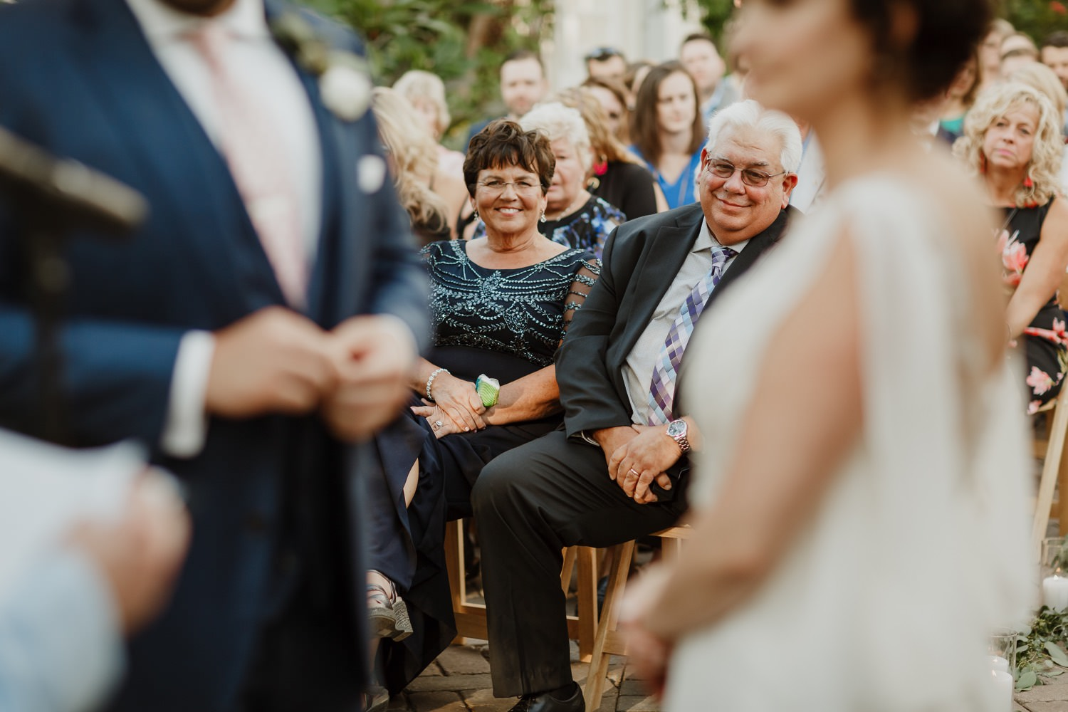 Picture of the parents of the groom taken during the exchange of the rings at Garfield Park Conservatory wedding