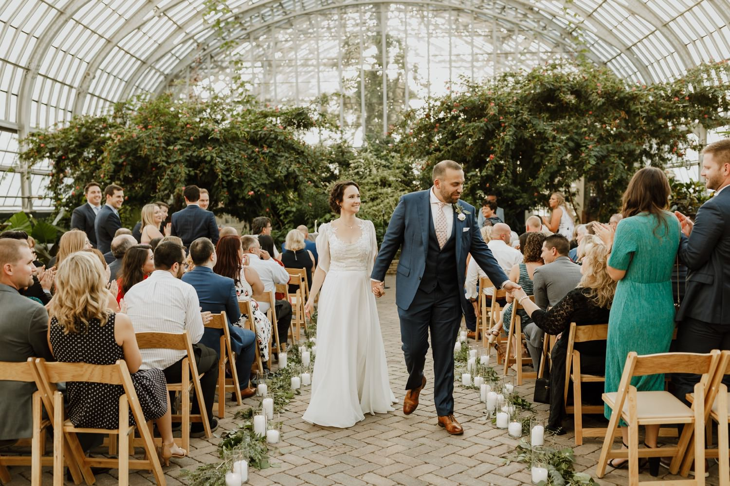 bride and groom walk down the isle after the ceremony at Garfield Park Conservatory in Chicago