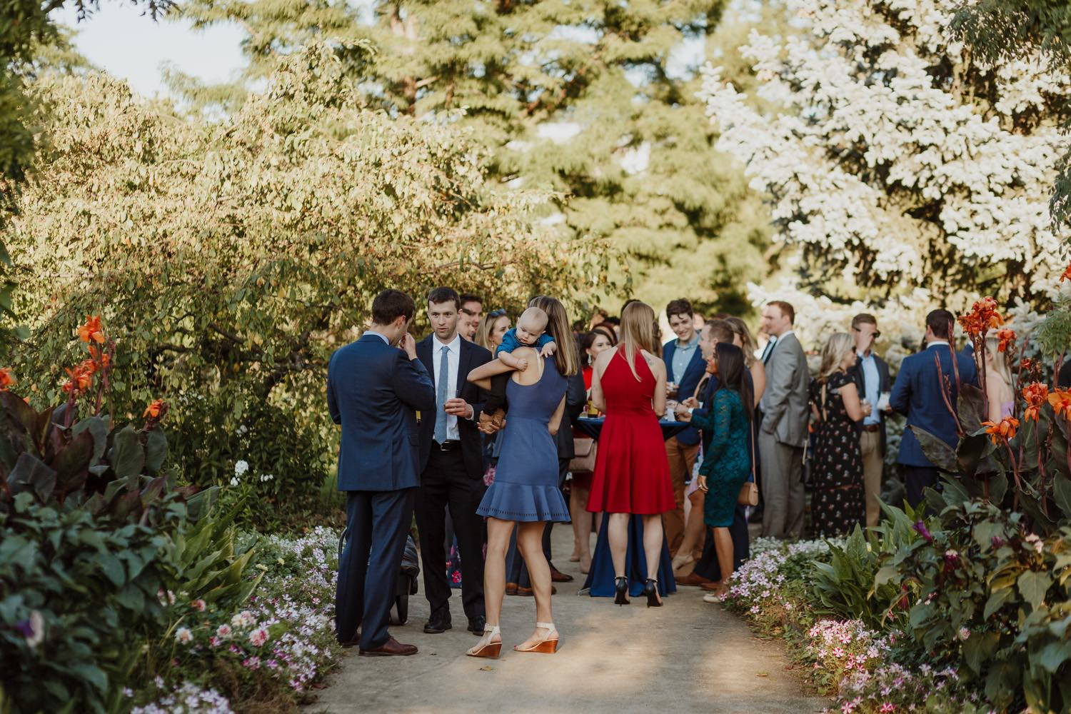 picture of guest mingling during the wedding at Garfield Park Conservatory in Chicago
