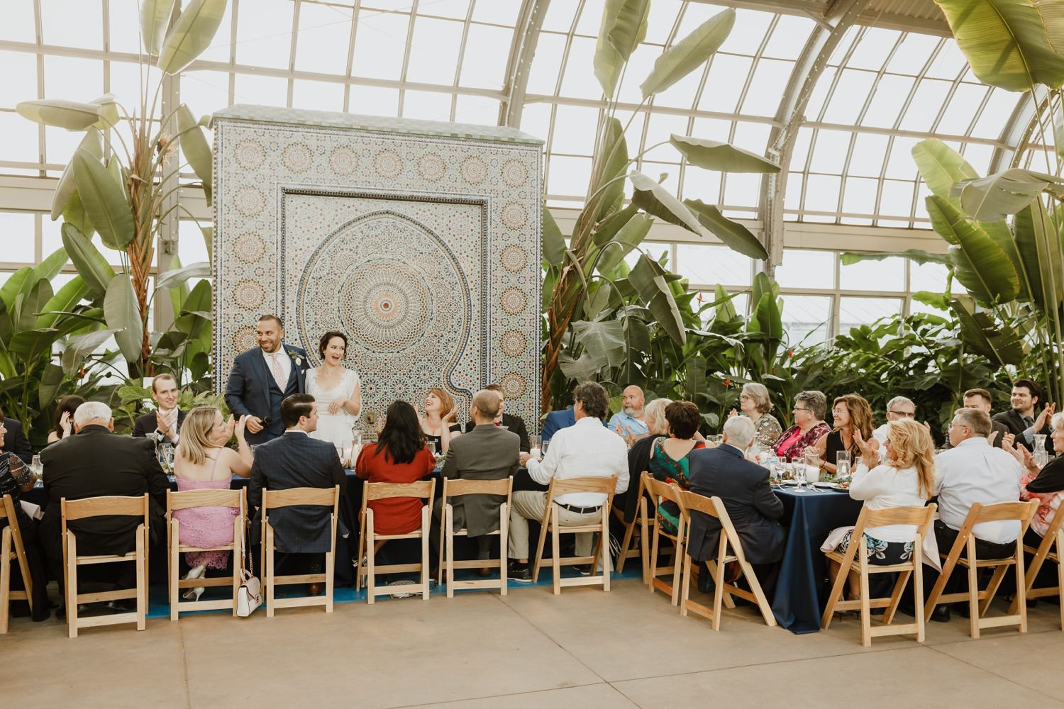 bride and groom greet their guest during the reception at Garfield Park conservatory