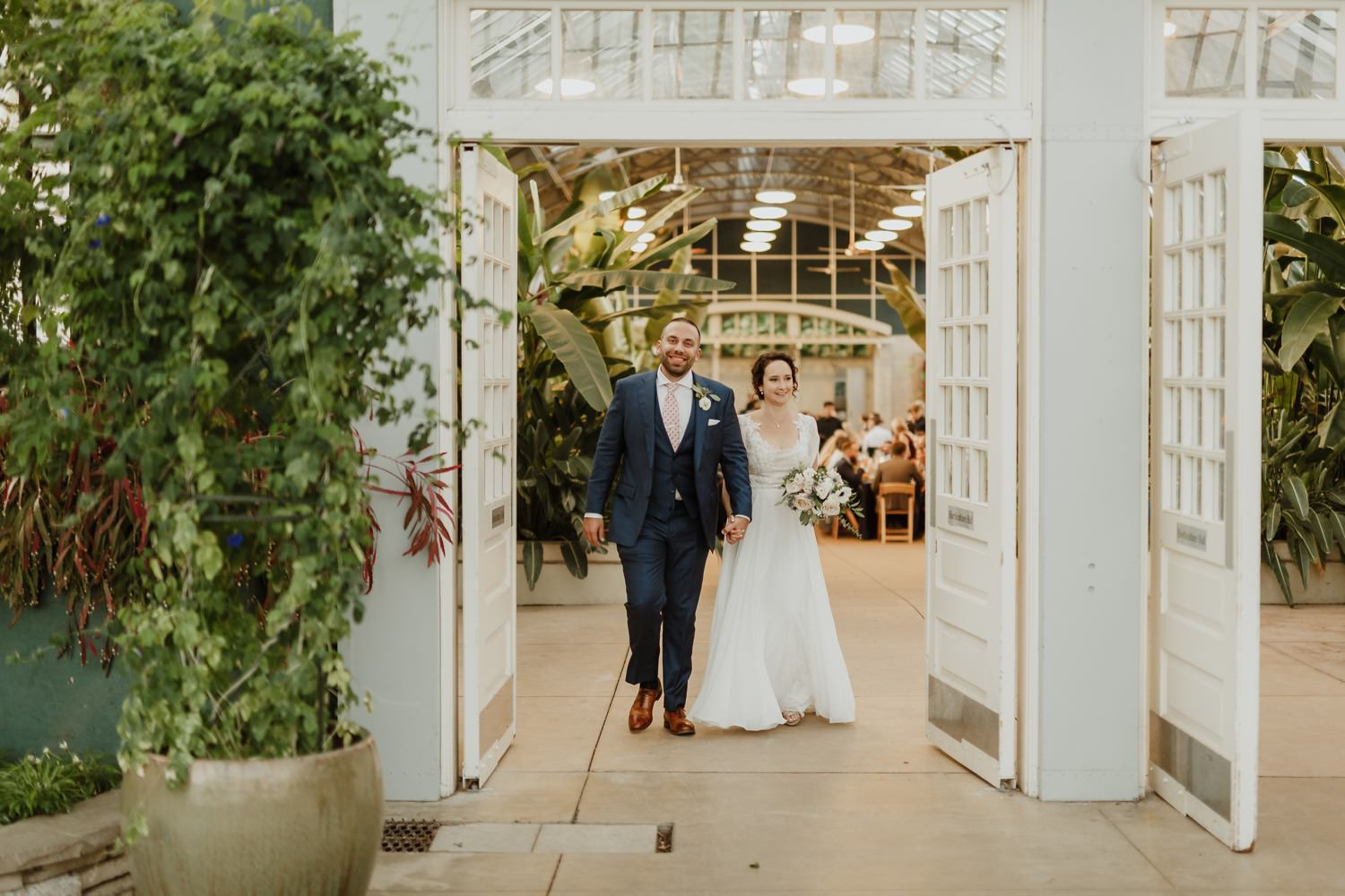 bride and groom walk for the portrait session at Garfield Park Conservatory