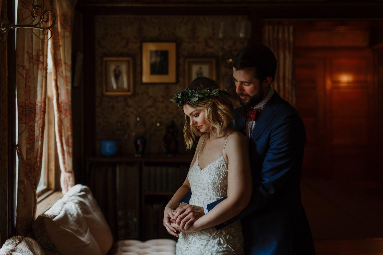 Bride and groom embrace inside
