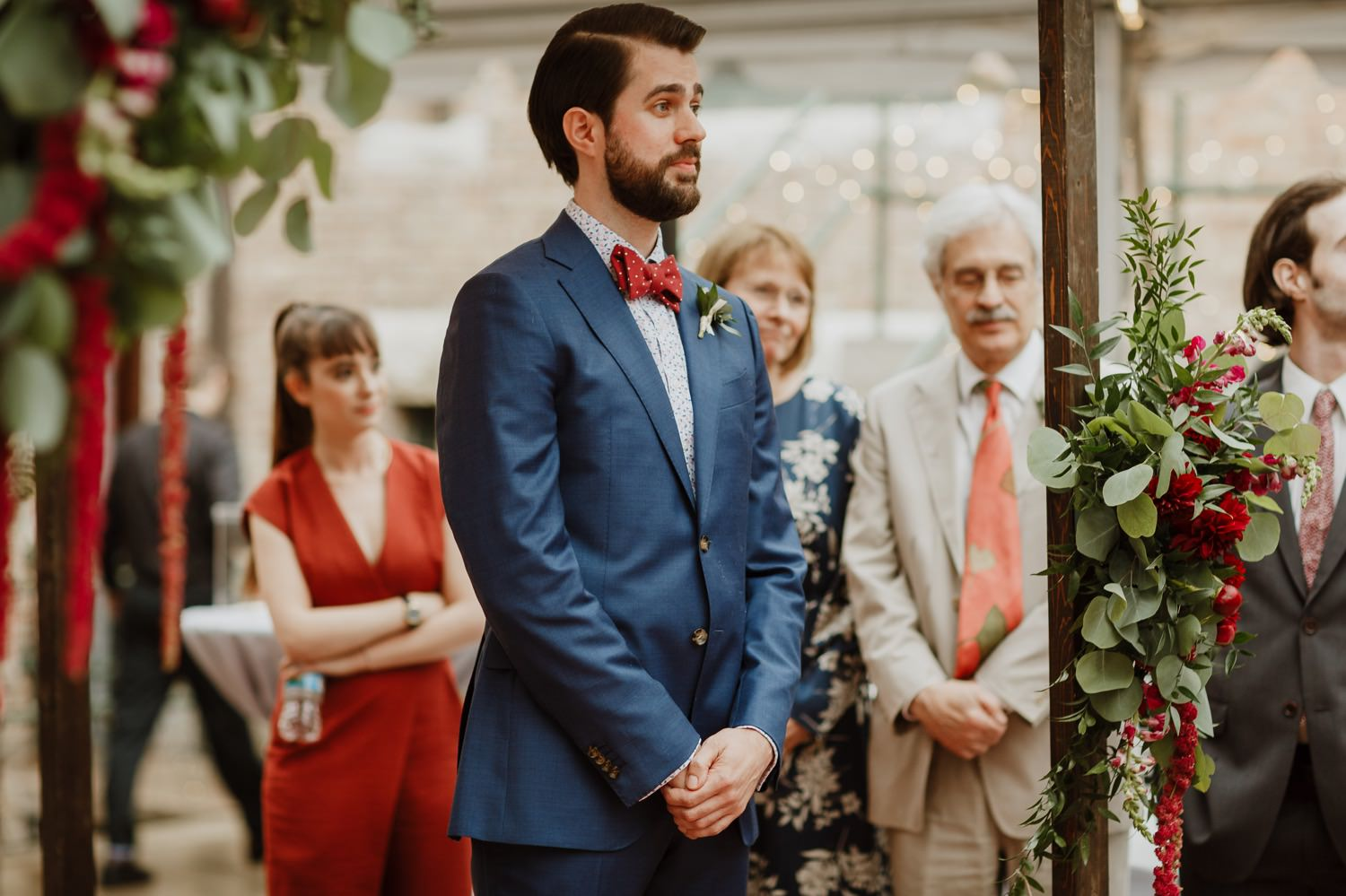 groom awaits the bride as she walks down the isle at Glessner House
