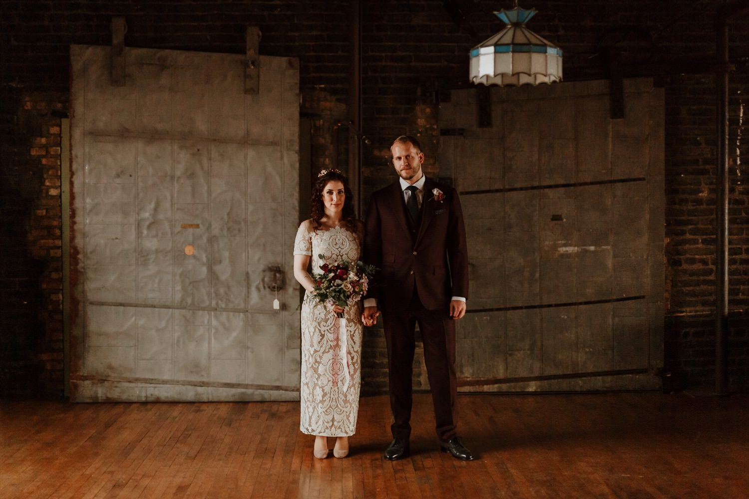 Classic portrait of the bride and groom taken at Salvage One during the ceremony