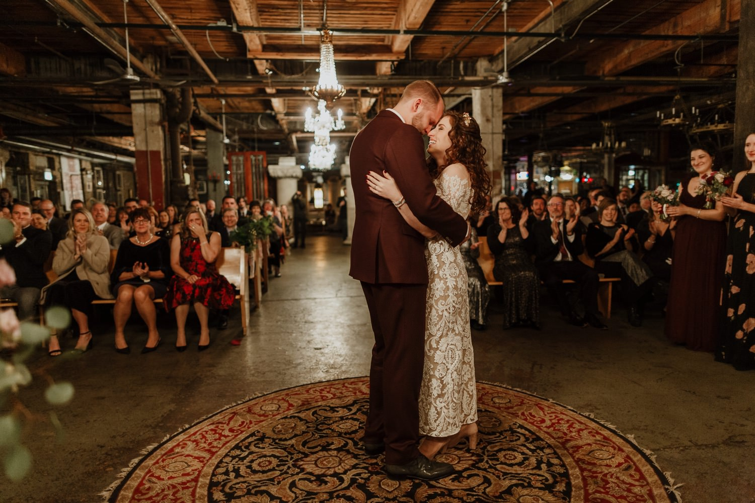 Bride and groom cherish a moment after first kiss at Salvage One