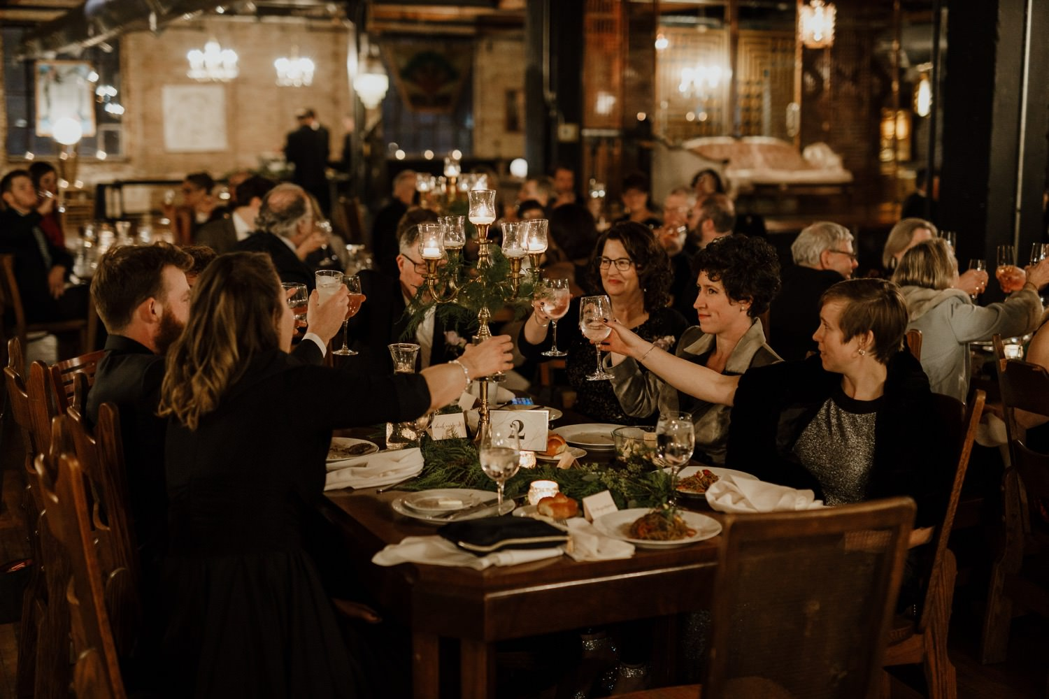 Guest toast and cheer at the wedding in Salvage ONe