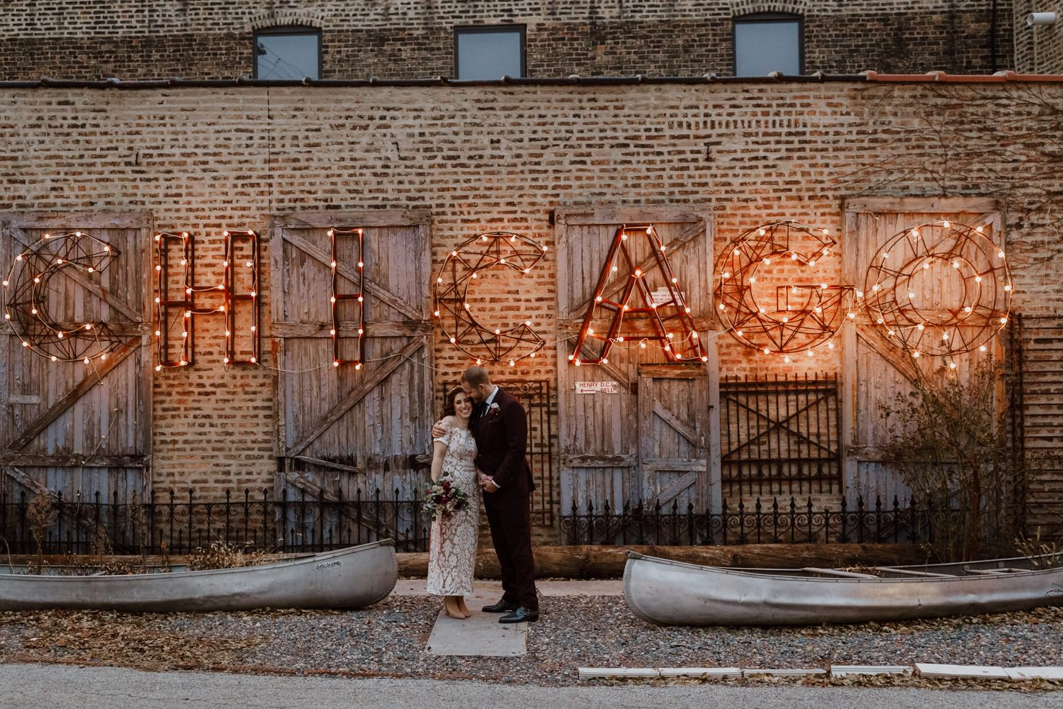 Portrait of the bride and groom at Salvage at Chicago sign