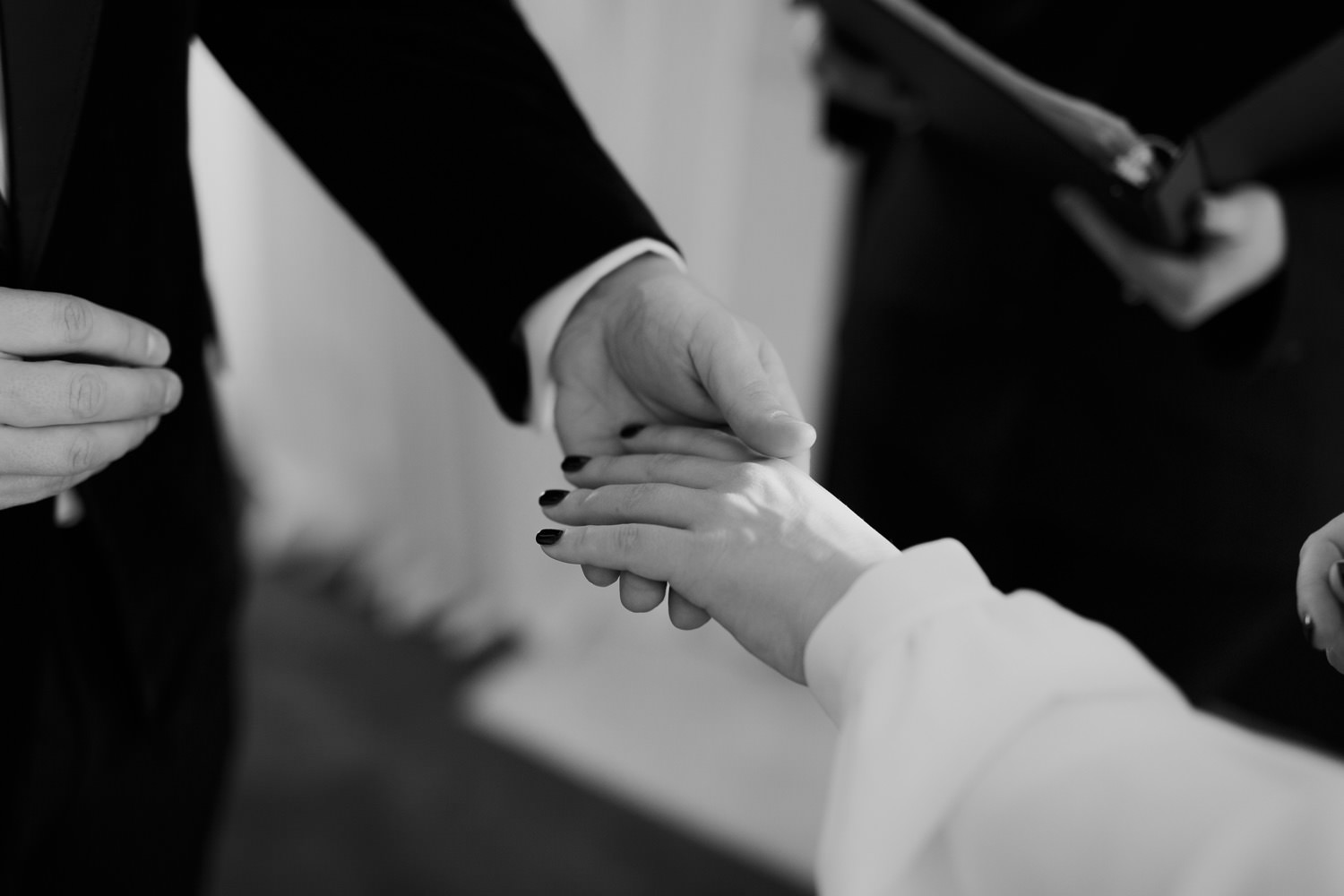 Bride and groom exchanging rings during their elopement in Chicago