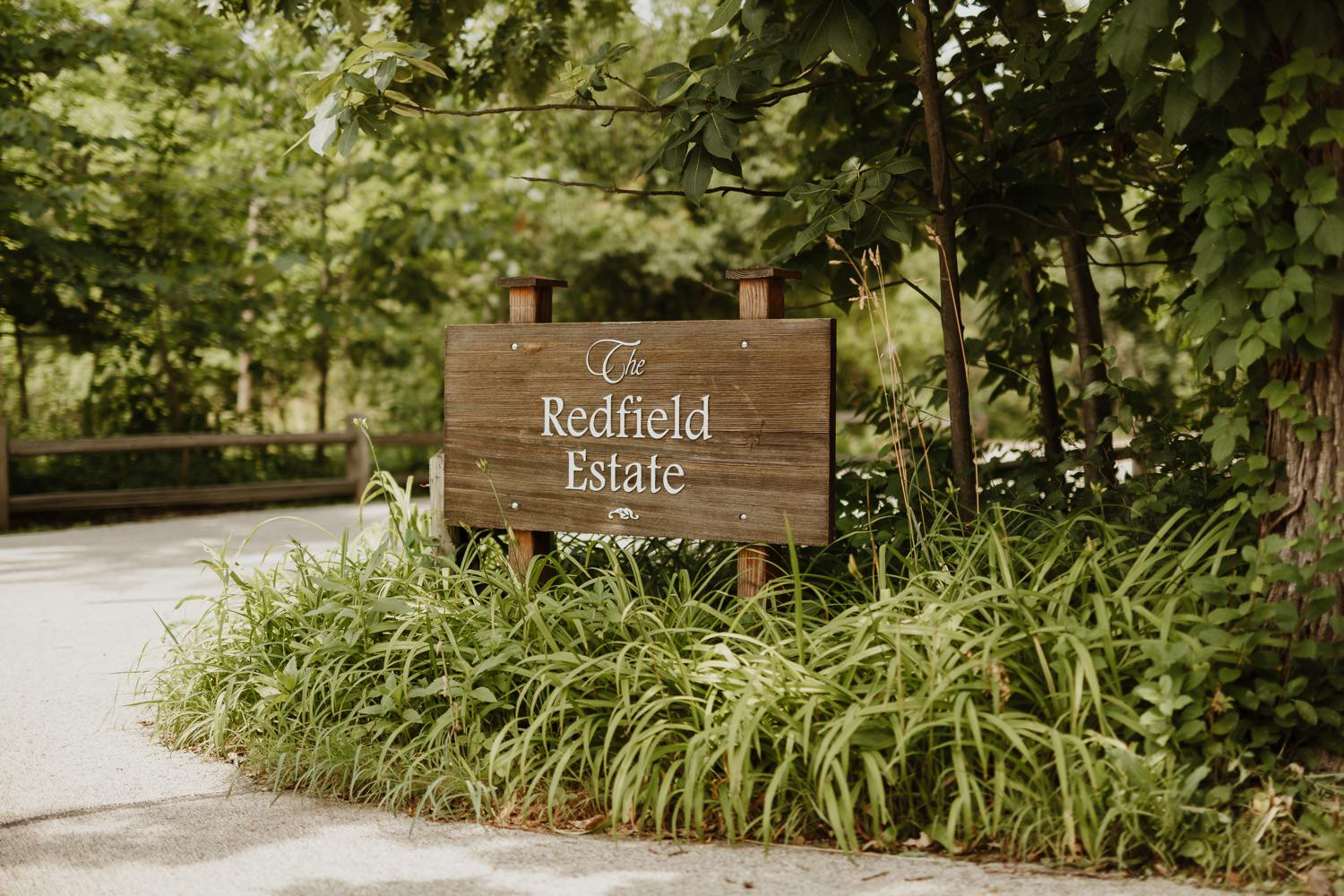 the sign at the entrance of the redfield estate