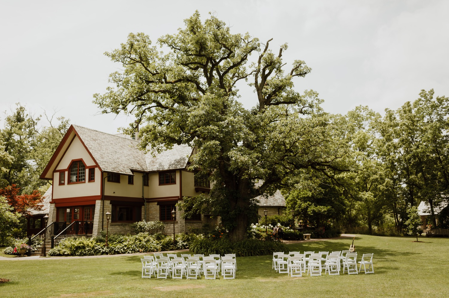picture of the wedding ceremony setup outside of the redfield estate mansion