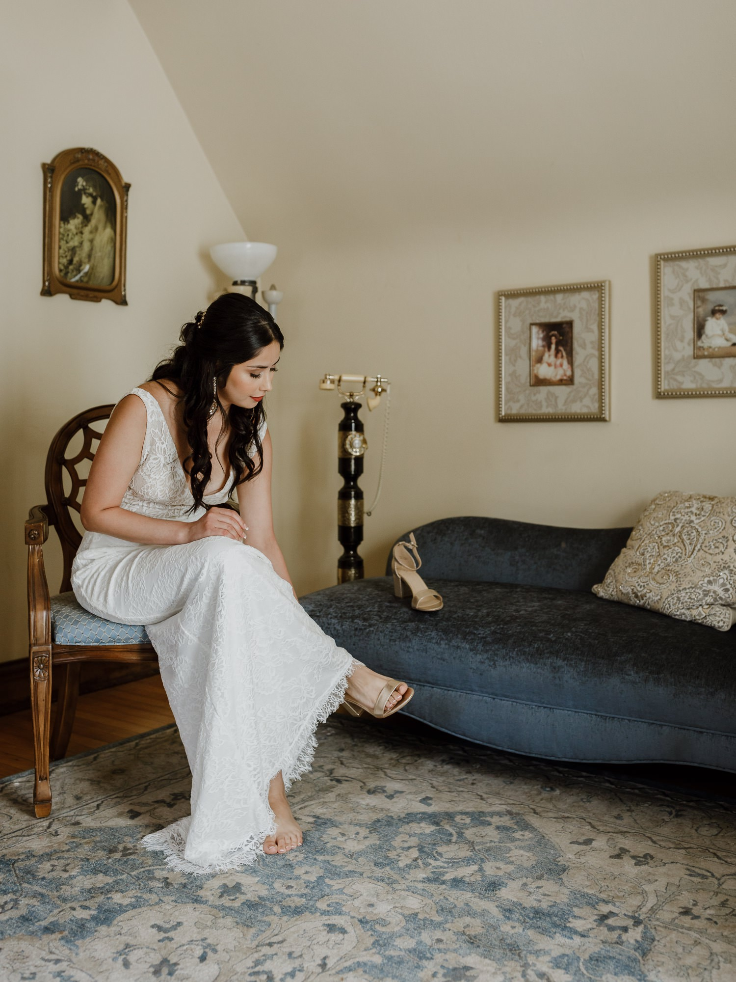 Bride putting on her wedding shoes at redfield estate bridal suite