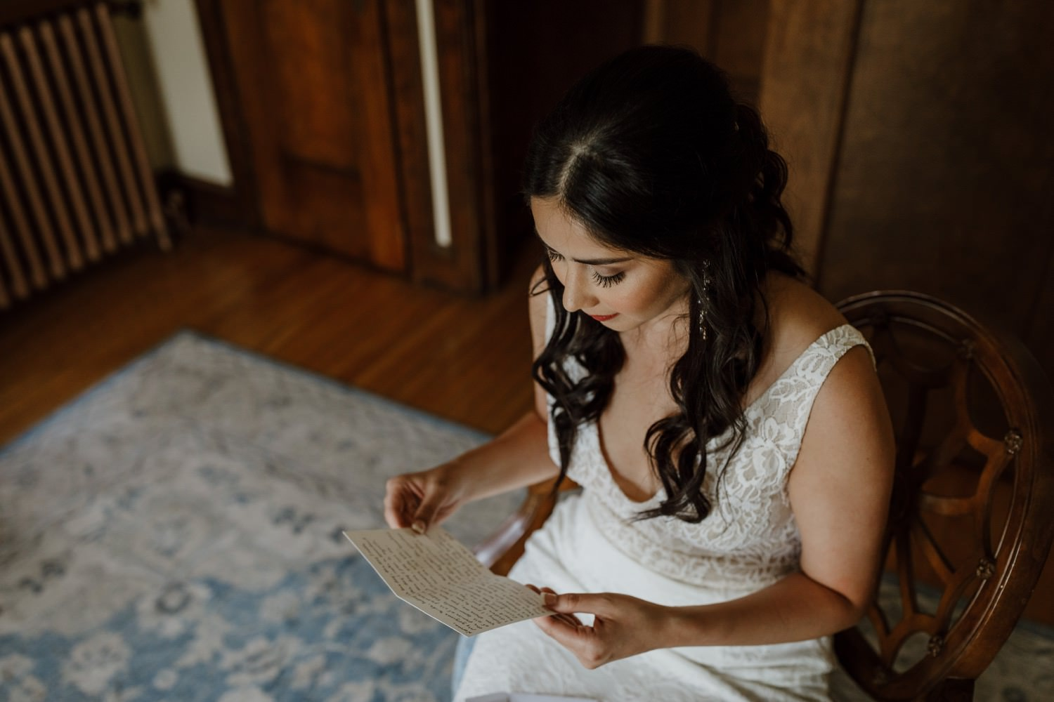 Bride reading the letter from the groom at redfield estate