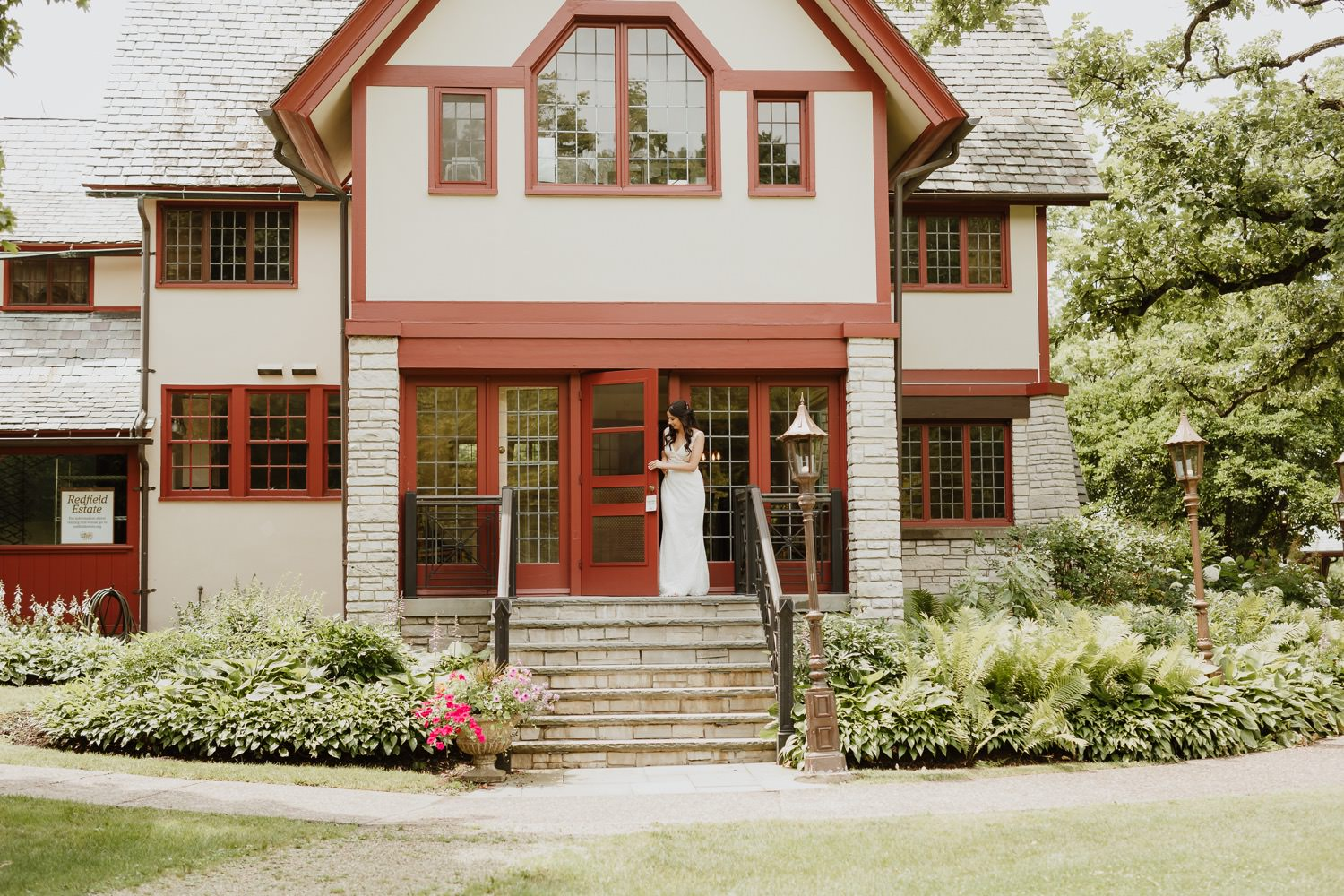 Bride walks out of the redfield estate mansion to meet her groom