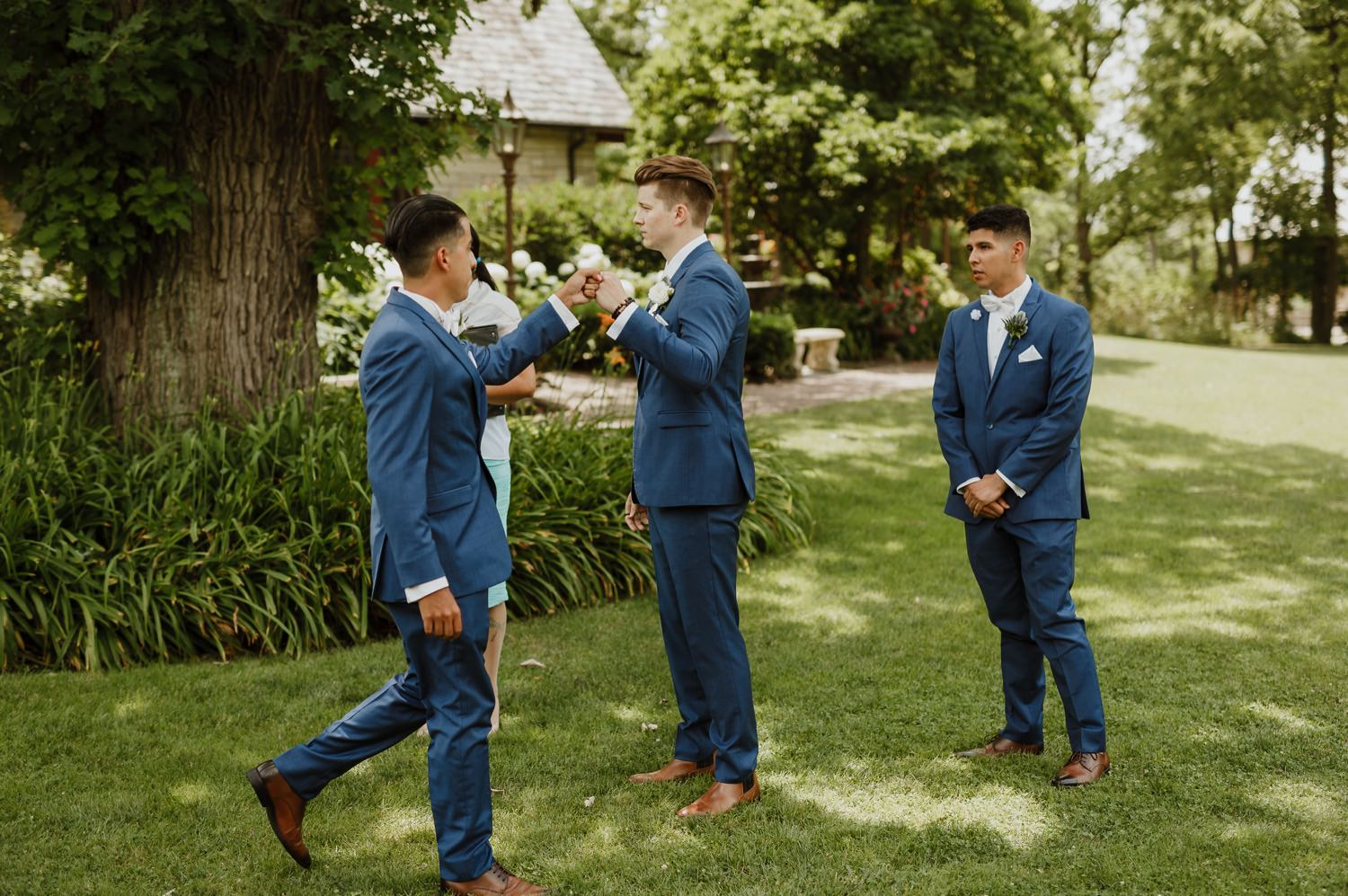 Groom greets his best men before the wedding ceremony at Redfield estate