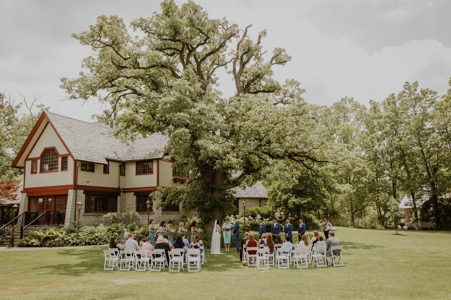 wide shot of the outdoor wedding ceremony at Redfield Estate