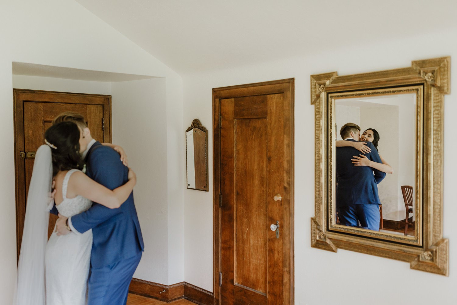 Bride and groom embrace in the intimate moment after the wedding ceremony at Redfield Estate