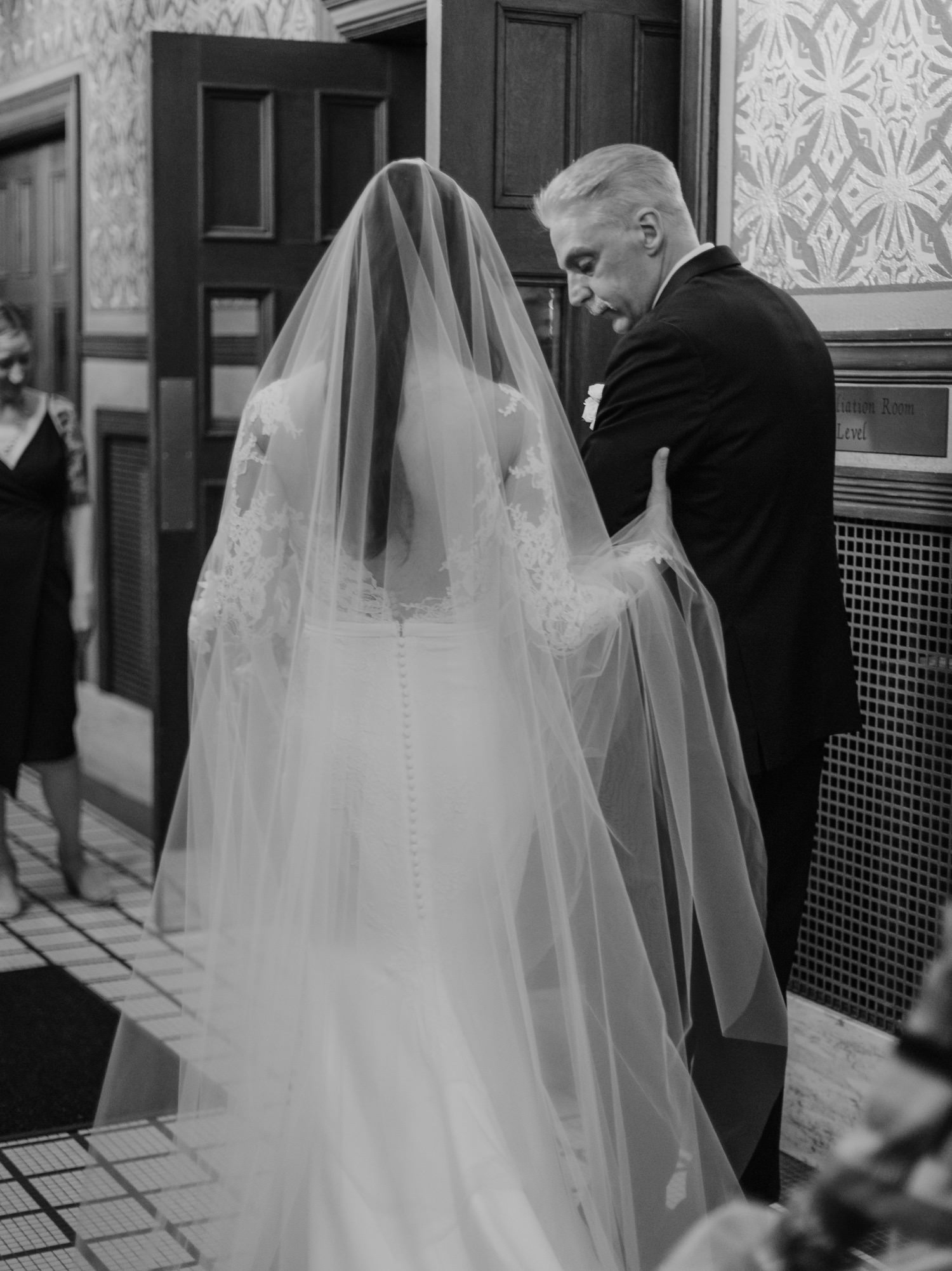 The bride being led down the isle by her father in St. Clement Church