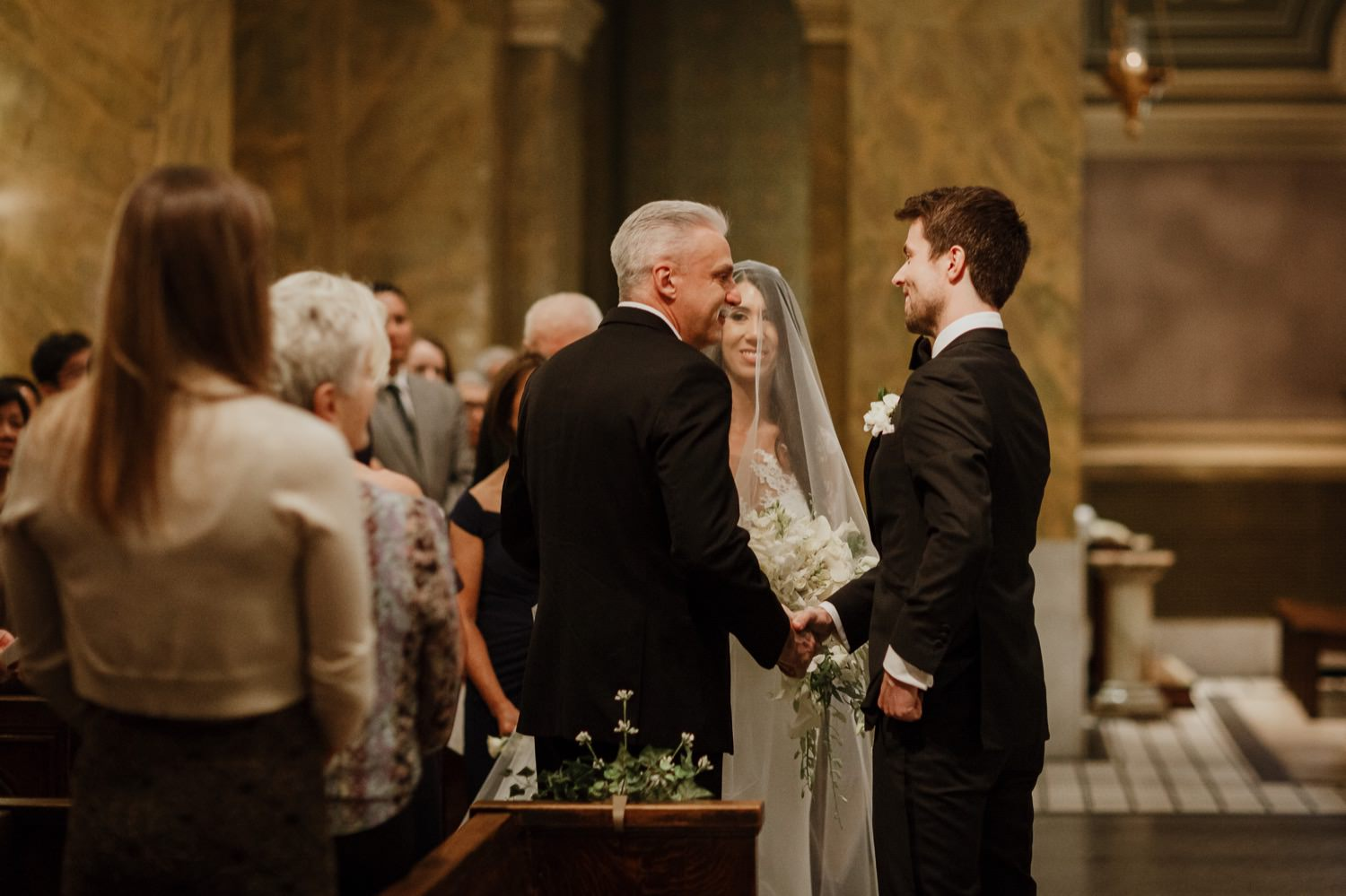 The groom giving away the bride in St. Clement Church on the wedding day