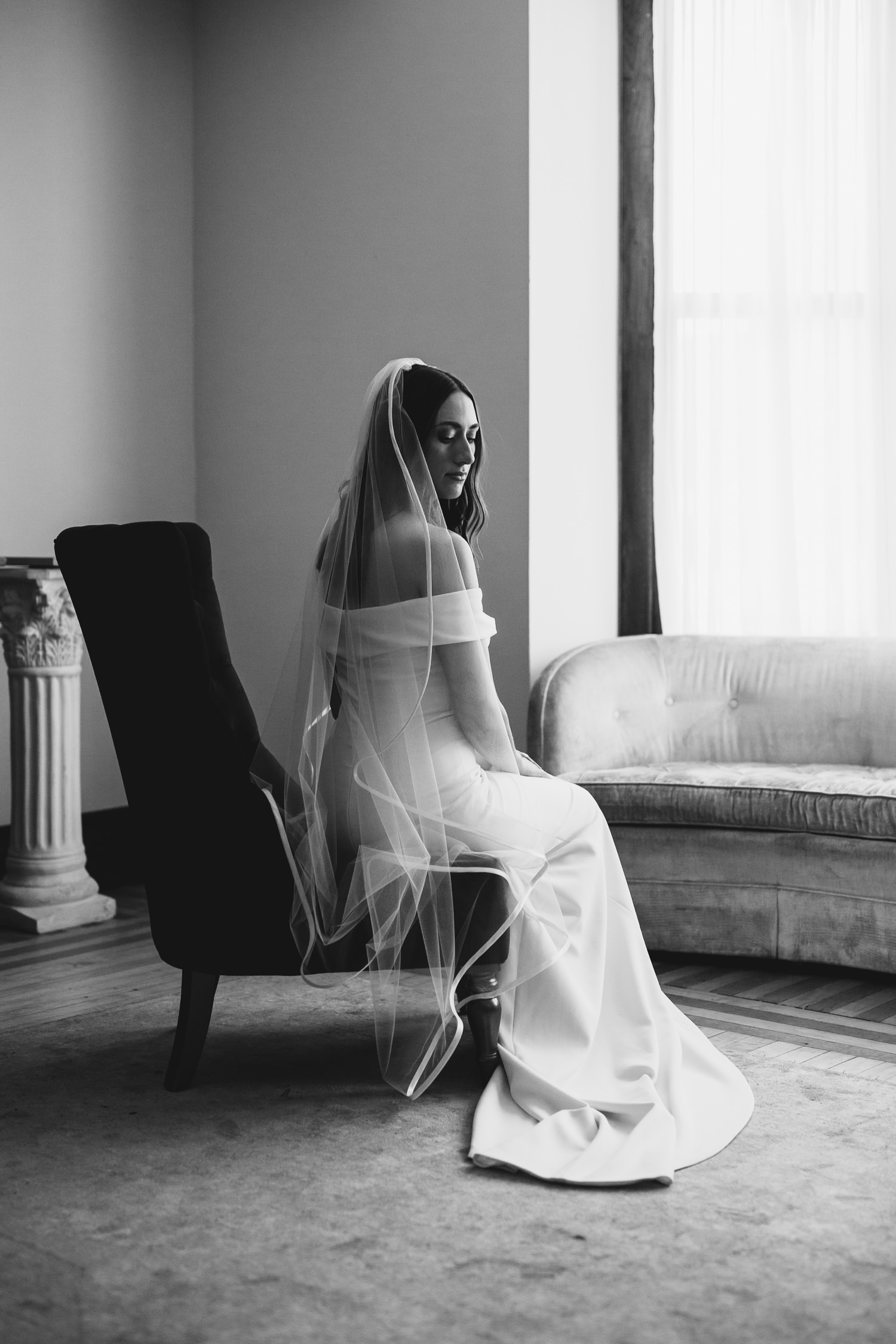 Portrait photo of the bride sitting in the bridal suite and the Haight