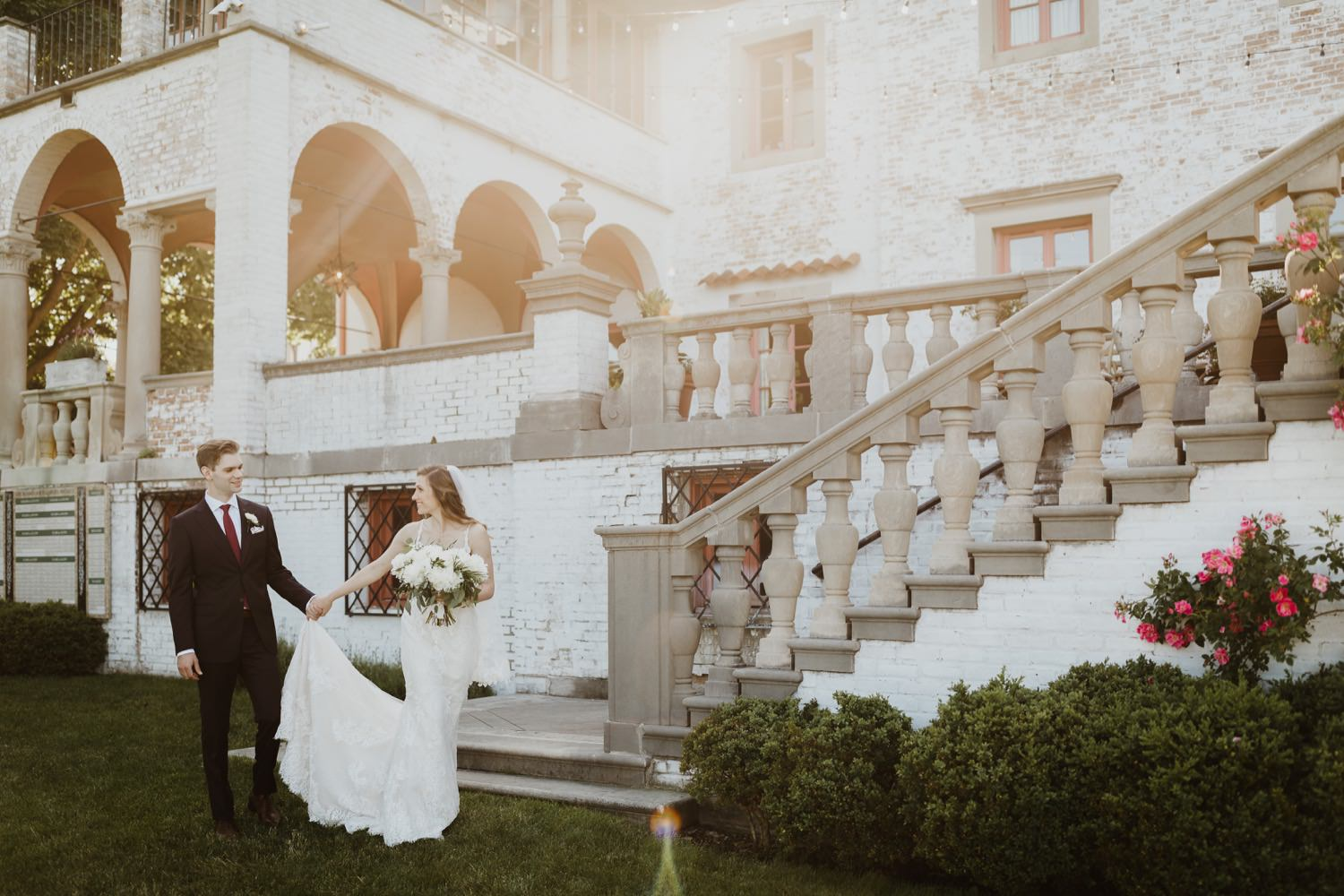 Bride and groom walk at the gardens of Villa Terrace in Milwaukee on their wedding day