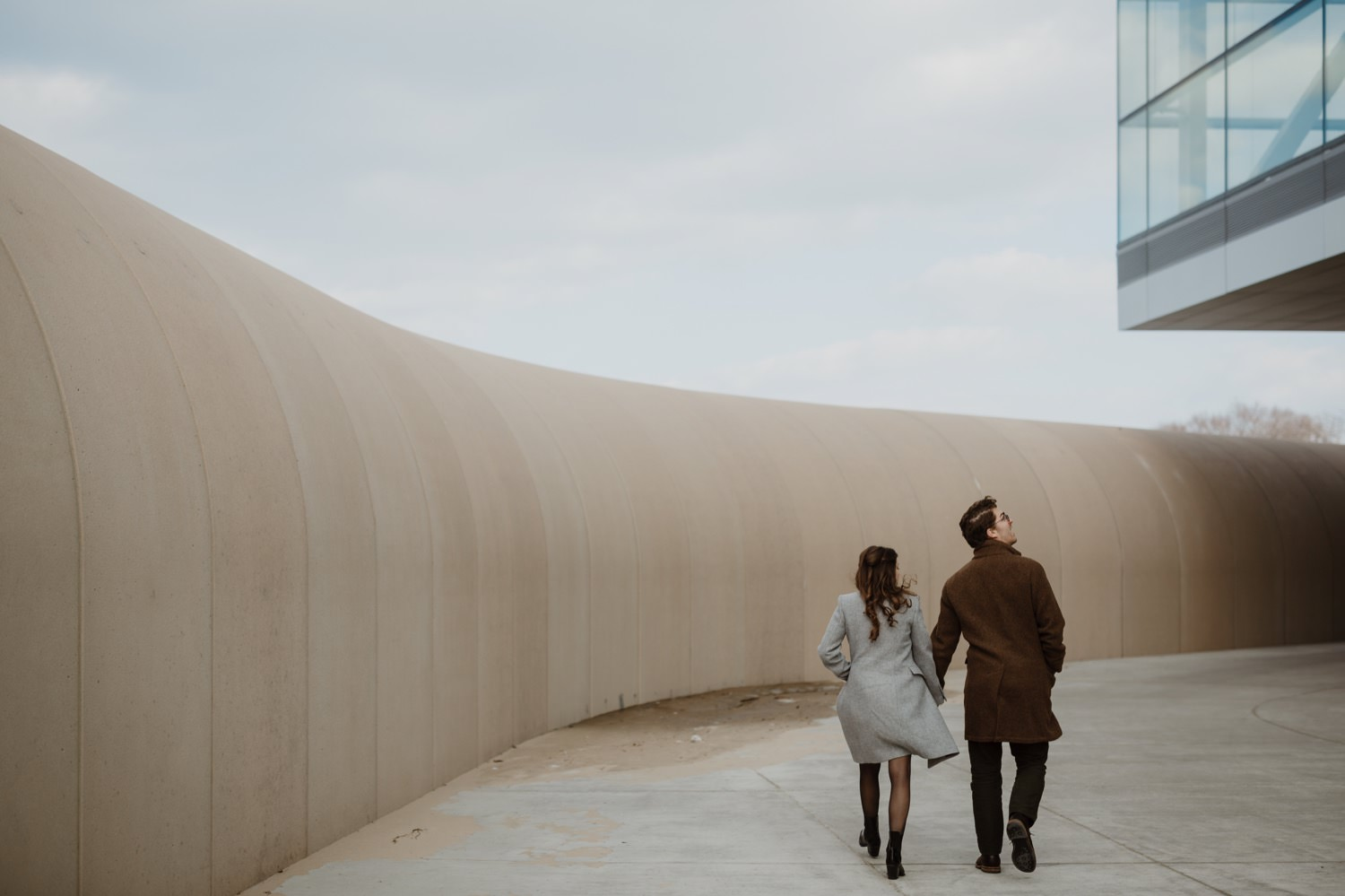 Couple walks by the lake at Northwestern University during their engagement portraits