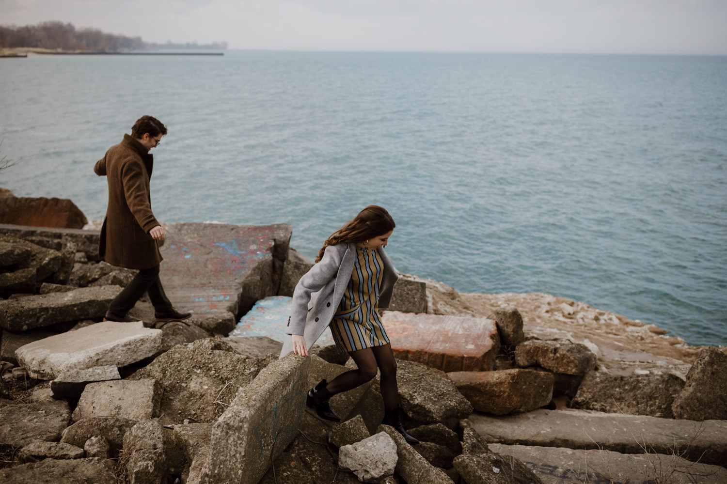 Bride and groom walks down by lake Michigan near Northwestern University. The photos take during their engagement session