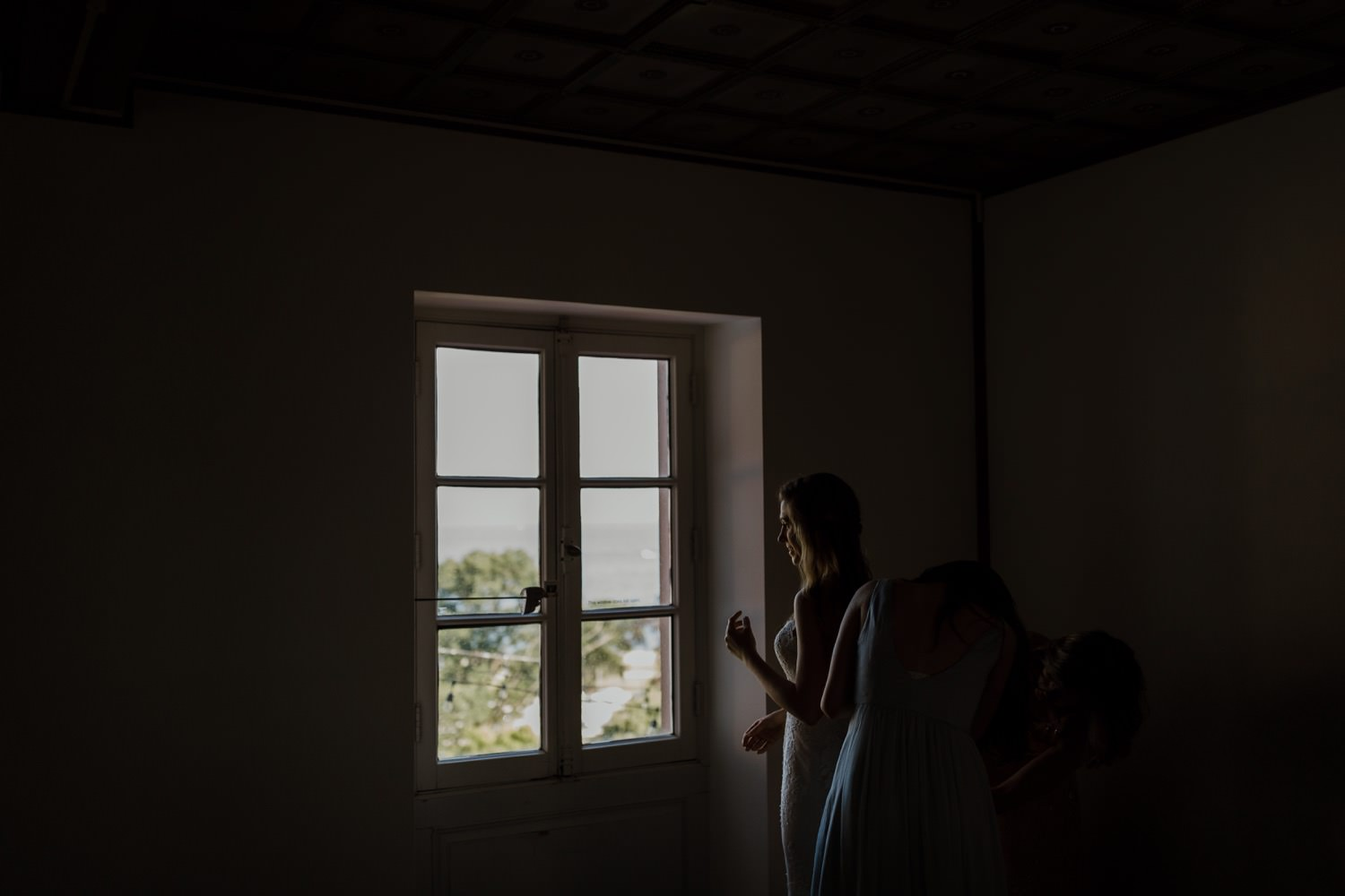 Bride getting ready by the window at Villa Terrace in Milwaukee