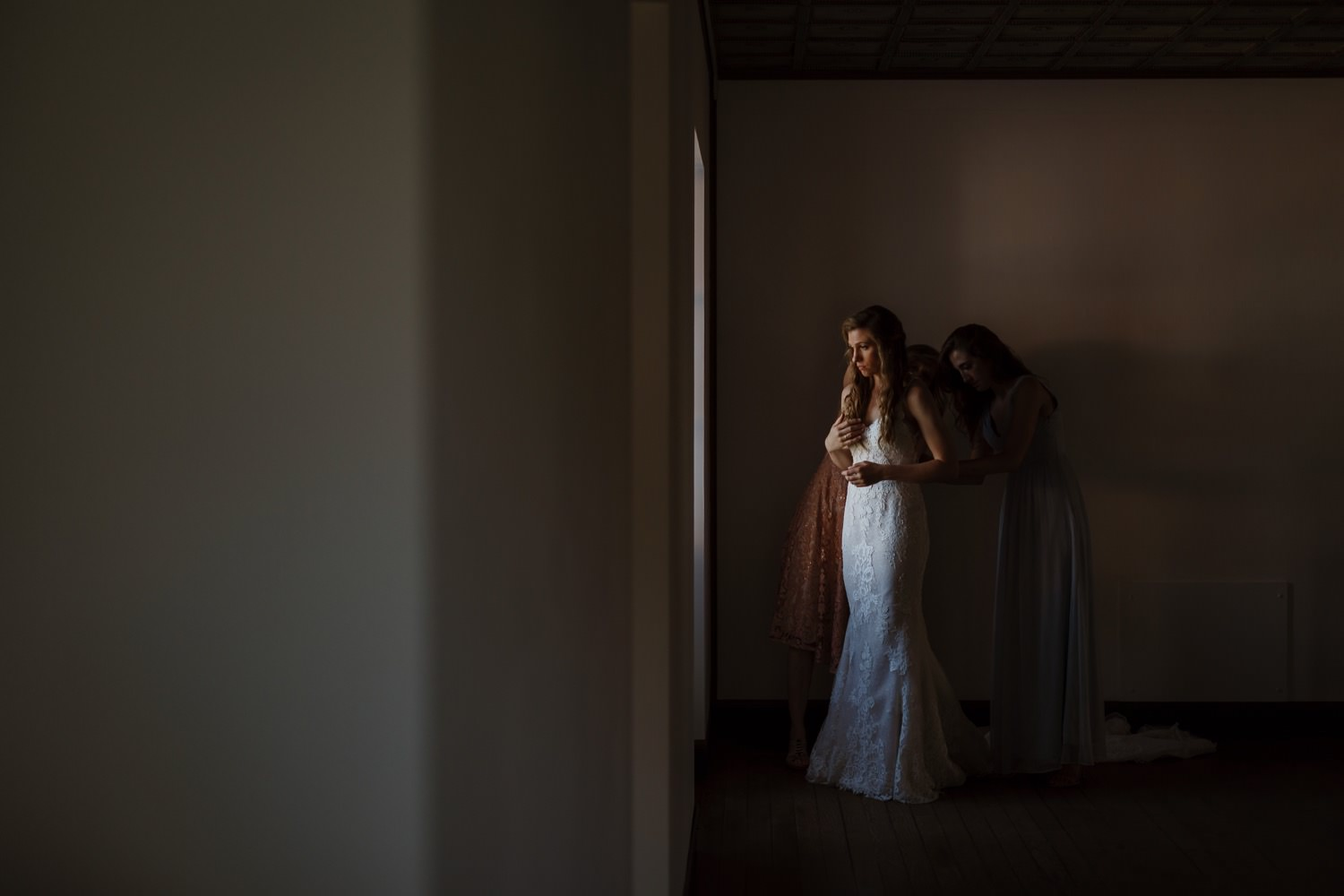 Bride puts on her wedding dress at Villa Terrace in Milwaukee