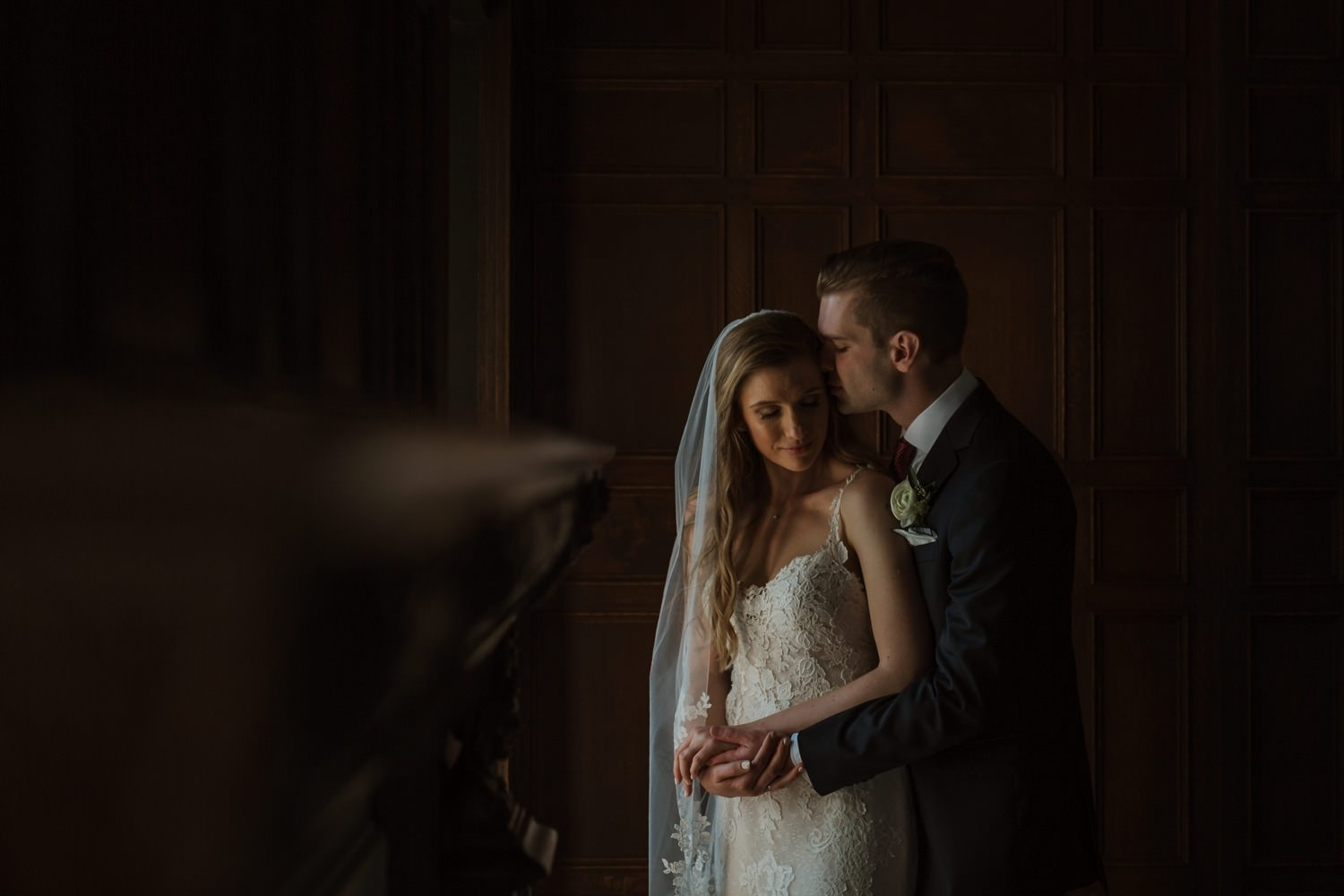 Bride and groom take an intimate wedding portrait inside the Villa Terrace in Milwaukee