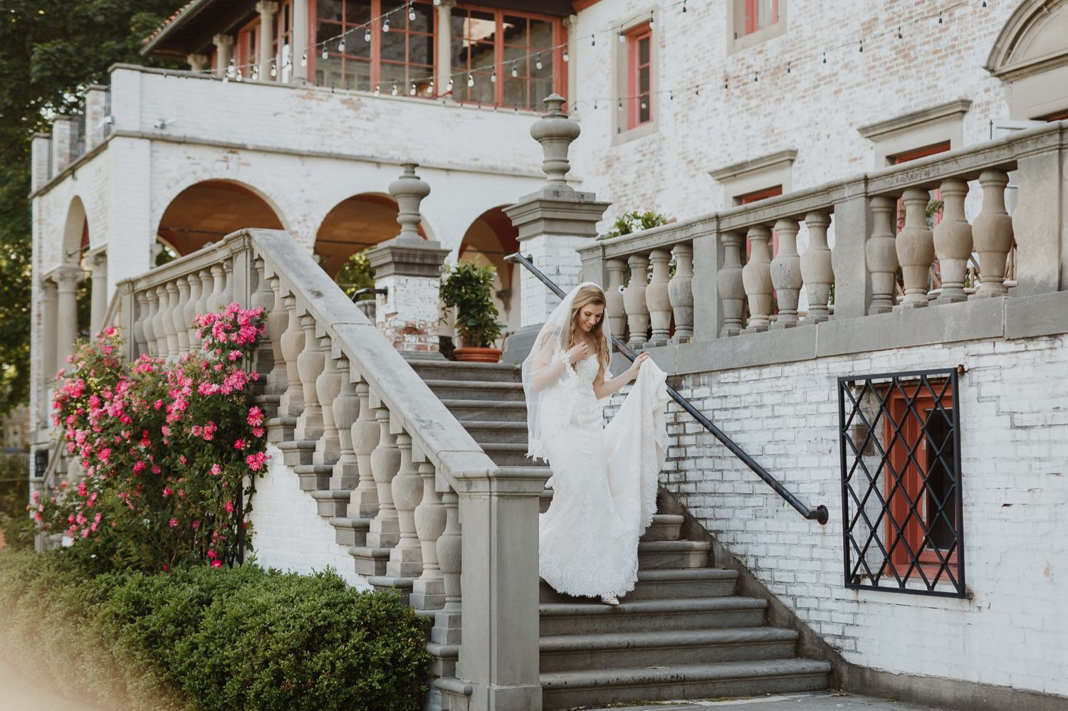 Bride walks down the stairs on the wedding day at Villa Terrace