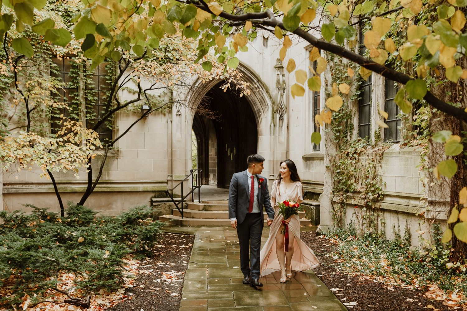 Bride and groom walk together at University of Chicago after their elopement ceremony