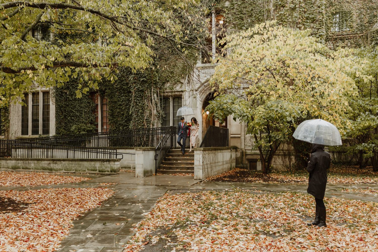 Bride and groom walk at the university campus before the elopement ceremony