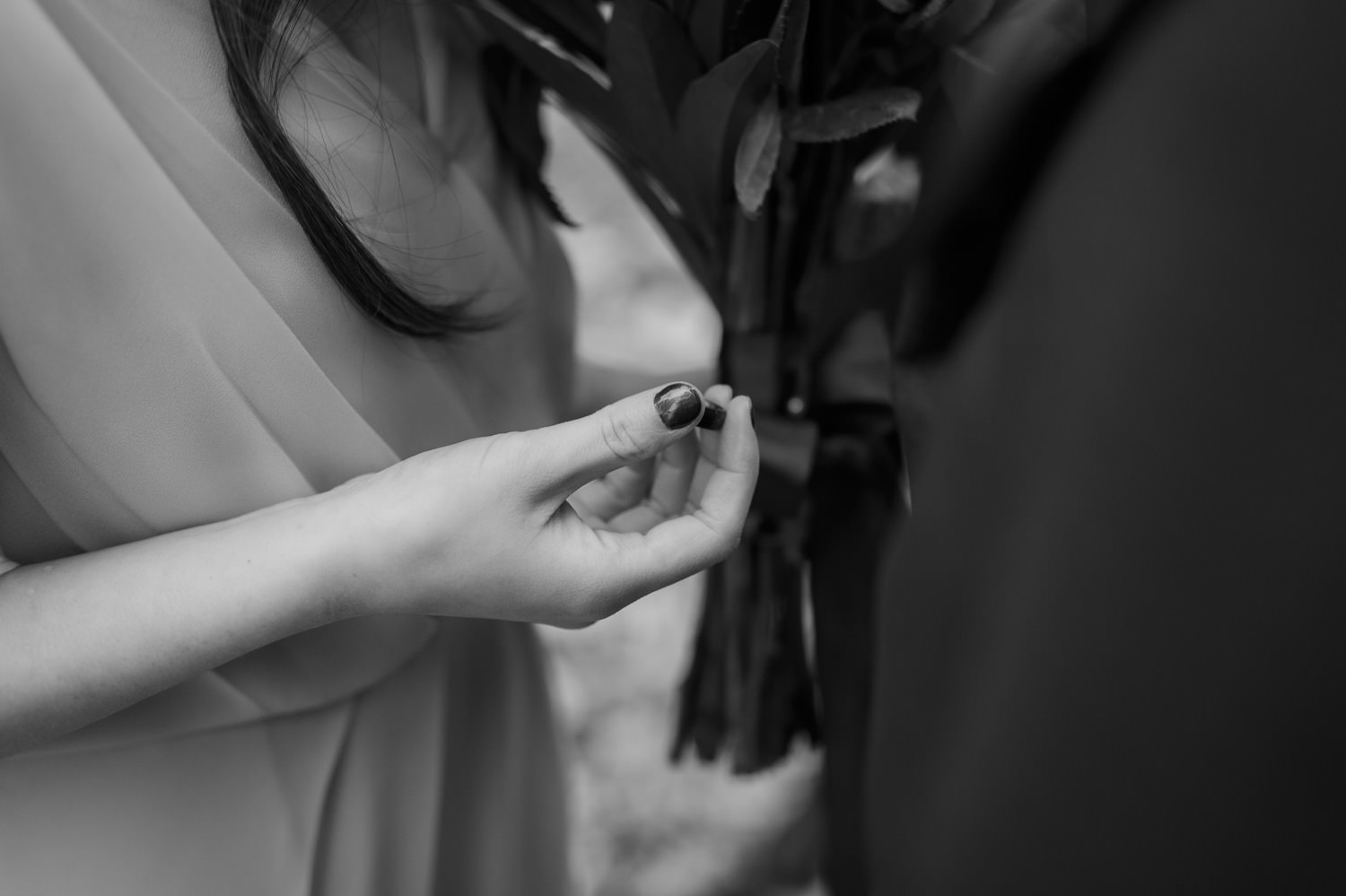 bride holds the wedding ring at University of Chicago