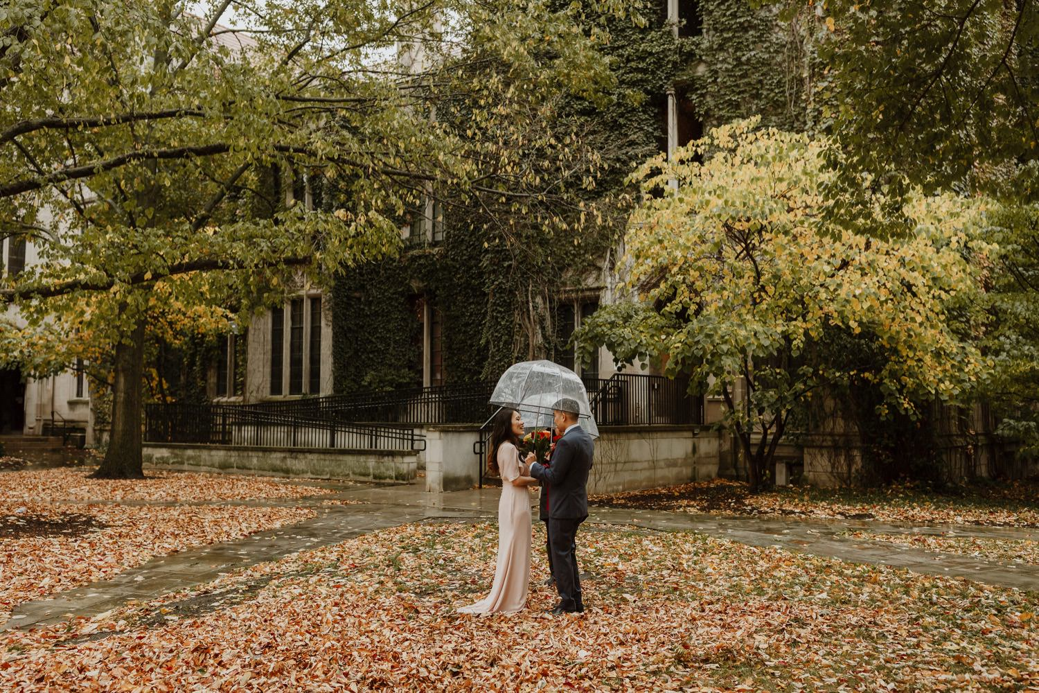 Bride and groom exchange vows at university of Chicago during the fall elopement