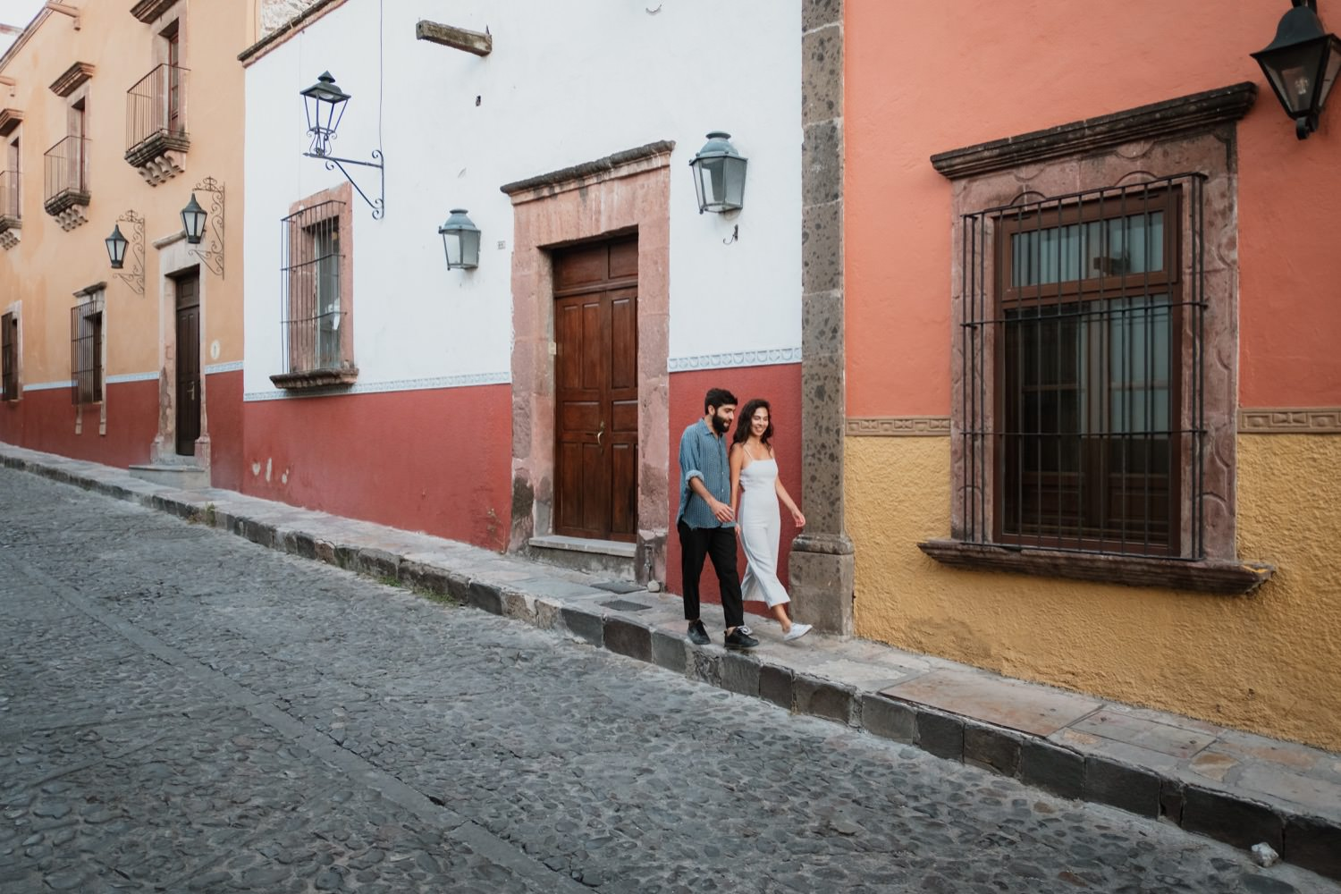 A couple walking down the street in San Miguel